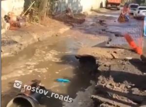 Зловонные реки из прорванной трубы затопили целую улицу в Ростове